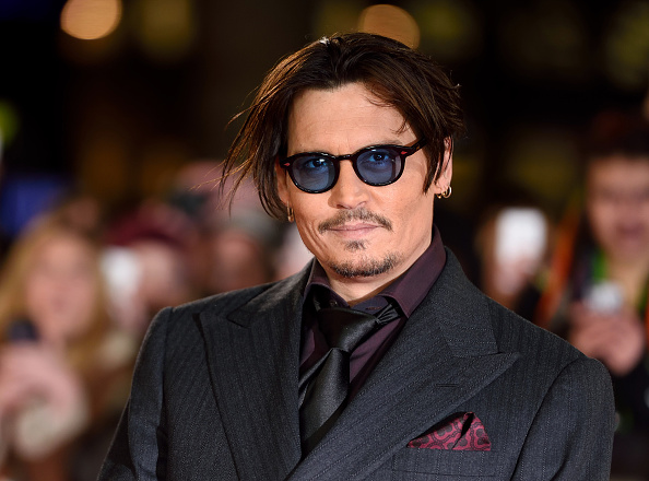 "Johnny Depp attends the UK Premiere of ""Mortdecai"" at Empire Leicester Square on January 19, 2015 in London, England."