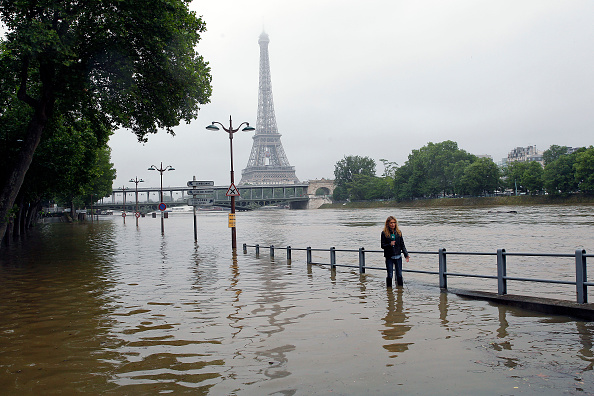 Water rises near the area of the Eiffel Tower as the Seine river's embankments overflow after four days of heavy rain in Paris.