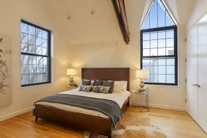 The bedroom also benefits from celestial ceiling heights.