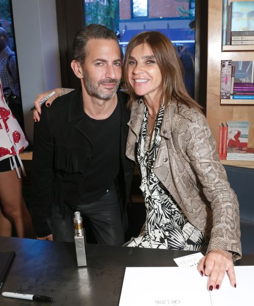 Marc Jacobs and queen Carine at his bookstore, Bookmarc.