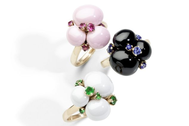 Pomellato Capri Ring in 18K Rose Gold, White Ceramic and Tsavorites, $2,100; Capri Ring in 18K Rose Gold, Pink Ceramic and Rubies, $2,100; Capri Ring in 18K Rose Gold, Black Ceramic and Blue Sapphires, $2,100