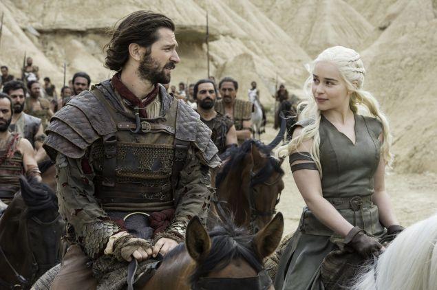 Michiel Huisman as Daario Naharis and Emilia Clarke as Daenerys Targaryen.