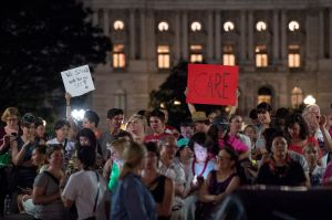 WASHINGTON, DC - JUNE 22: Supporters of House Democrats taking part in a sit-in on the House Chamber shout encouragement from outside the U.S. Capitol on June 22, 2016 in Washington, DC. Led by civil rights icon Rep. John Lewis (D-GA) Democrats, have maintained control of the House chamber since this morning demanding a vote on gun control legislation.