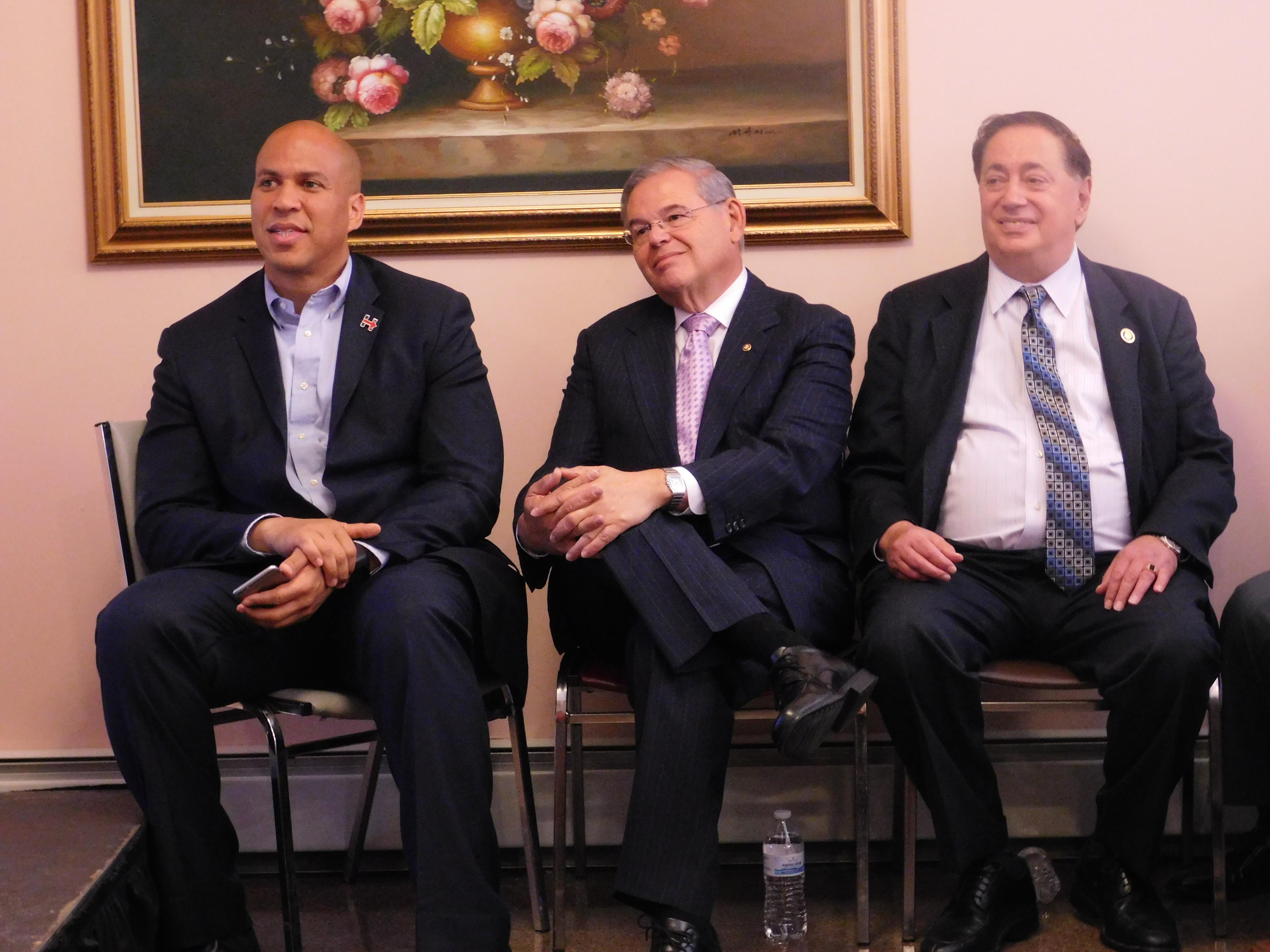 Booker, Menendez and Sacco listen to Chelsea Clinton speak.
