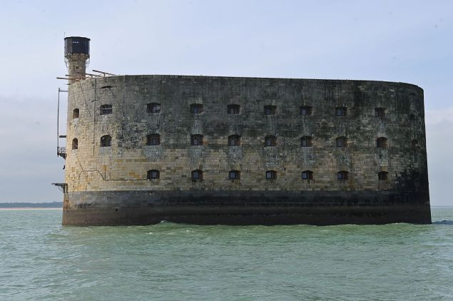 This picture taken on April 22, 2016, shows a general view of the Fort Boyard, off the western coast of France, near La Rochelle. A new access platform to the Fort Boyard was inaugurated on Friday. The Charente-Maritime county council, owner of the site, invested around 2 million euros in this work, routed from the Netherlands where it was built by the Ravestein company. / AFP / XAVIER LEOTY