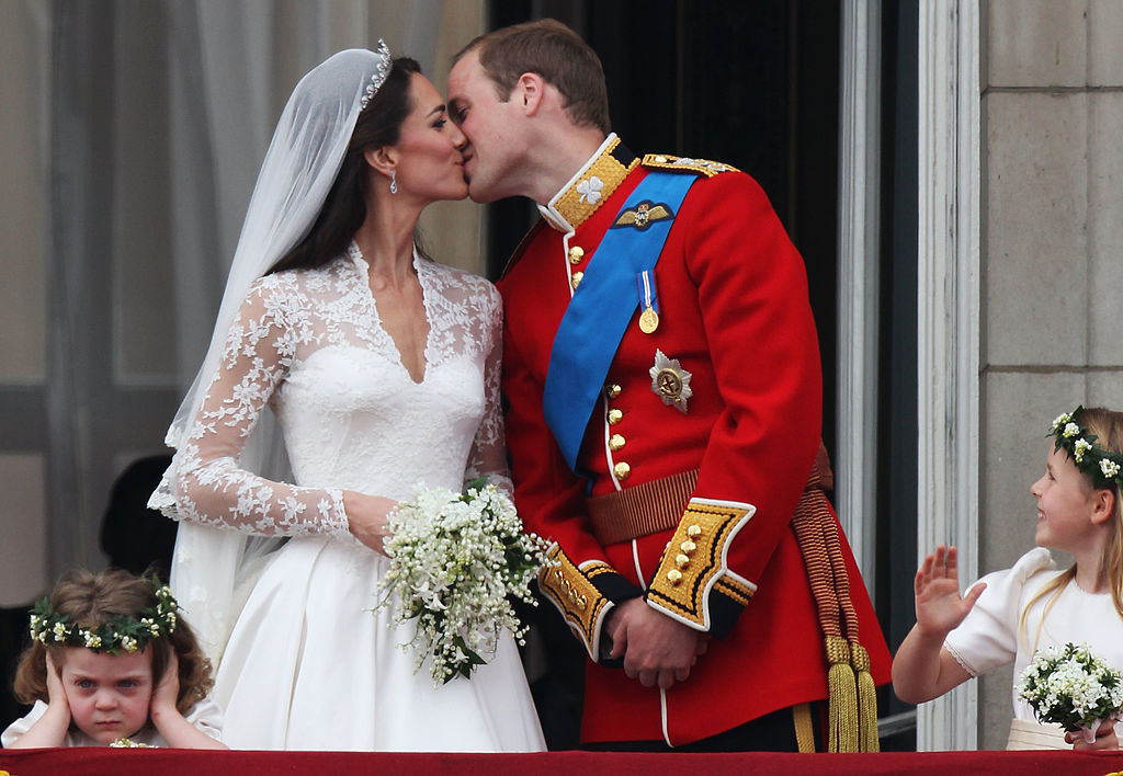 Their Royal Highnesses Prince William, Duke of Cambridge and Catherine, Duchess of Cambridge kiss on the balcony at Buckingham Palace on April 29, 2011 in London, England. The marriage of the second in line to the British throne was led by the Archbishop of Canterbury and was attended by 1900 guests, including foreign Royal family members and heads of state. Thousands of well-wishers from around the world have also flocked to London to witness the spectacle and pageantry of the Royal Wedding.