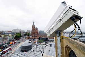 A CCTV security camera looks down towards King's Cross Square, London.