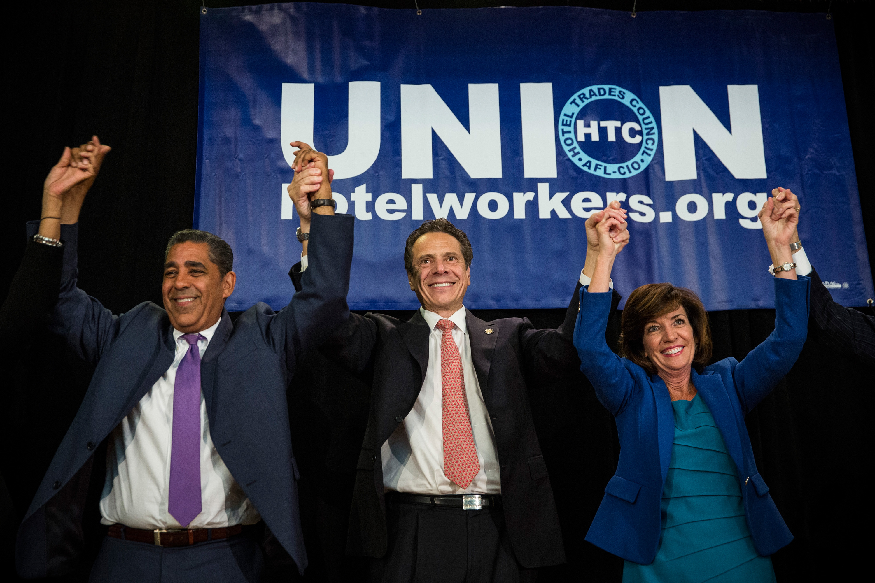 New York Governor Andrew Cuomo (C), his choice for Lieutenant Governor, former congresswoman Kathy Hochul (R) and New York State Senator Adriano Espaillat campaign together at the Hotel Trade Council during a reelection campaign event on September 8, 2014 in New York City.