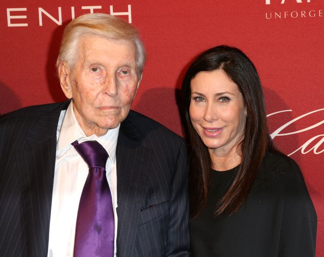 Sumner Redstone (L) and Sydney Holland attend The Hollywood Reporter's Annual Nominees Night Party at Spago on February 10, 2014 in Beverly Hills, California.