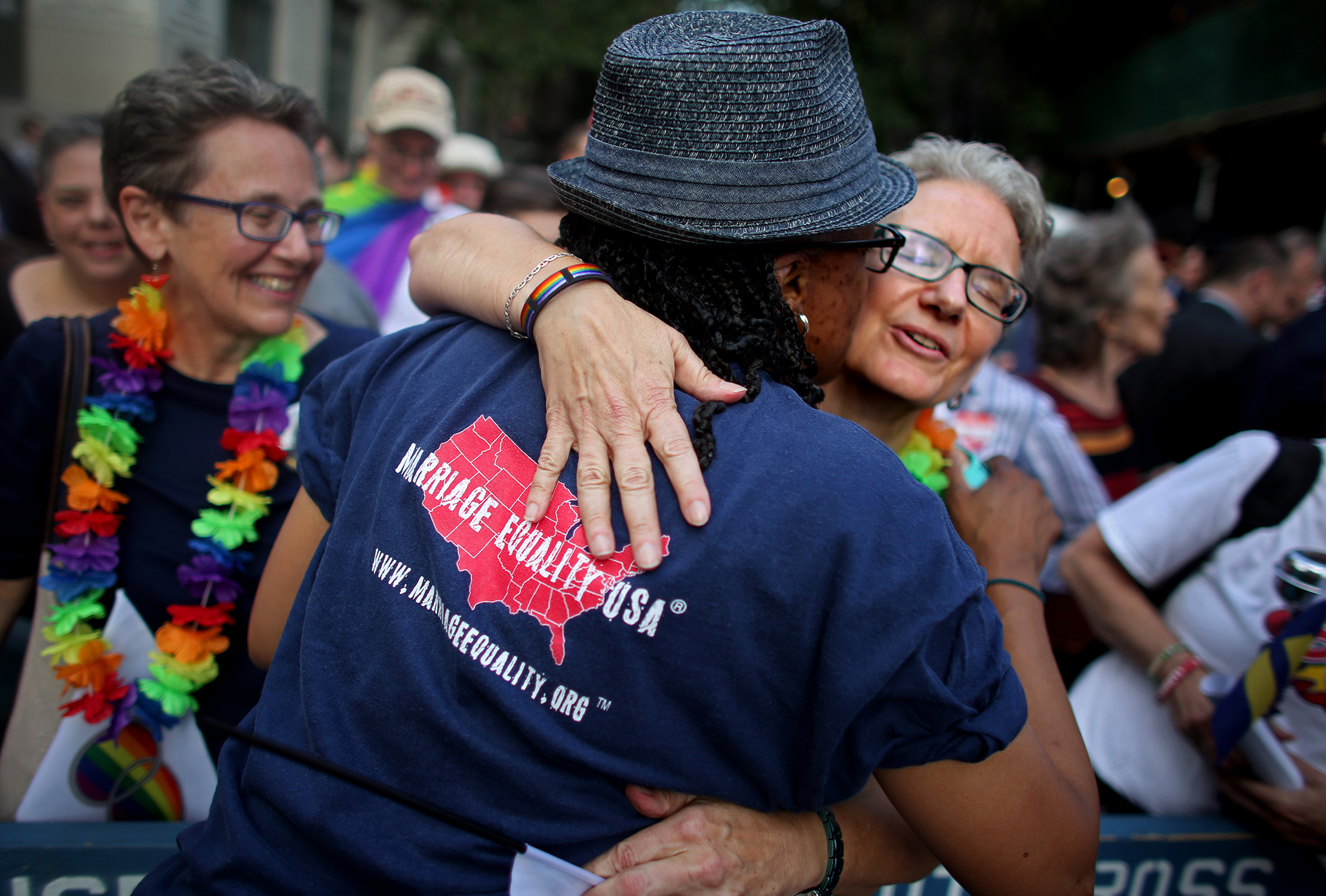 Sheila Marino-Thomas, 52, hugs a friend during a rally in front of the Stonewall Inn after marriage was made legal nationwide.