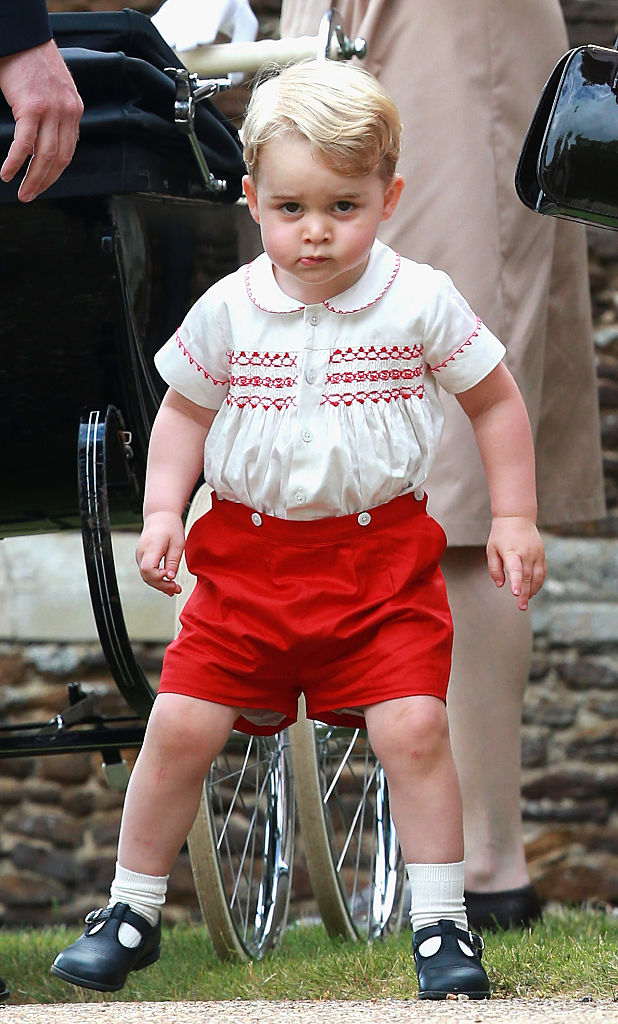 KING'S LYNN, ENGLAND - JULY 05: Prince George of Cambridge leaves the Church of St Mary Magdalene on the Sandringham Estate for the Christening of Princess Charlotte of Cambridge on July 5, 2015 in King's Lynn, England.