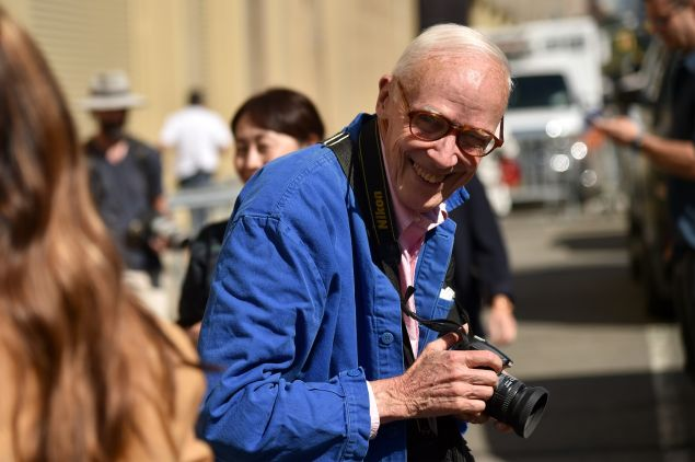 Bill Cunningham at work in his legendary blue jacket