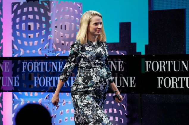 Marissa Mayer sports a baby bump while speaking at Fortune Global Forum last November.