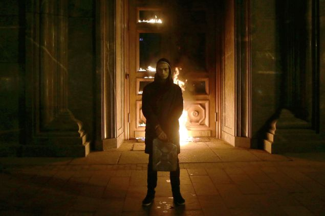 Russian artist Pyotr Pavlensky poses after setting fire to the doors of the headquarters of the FSB security service.