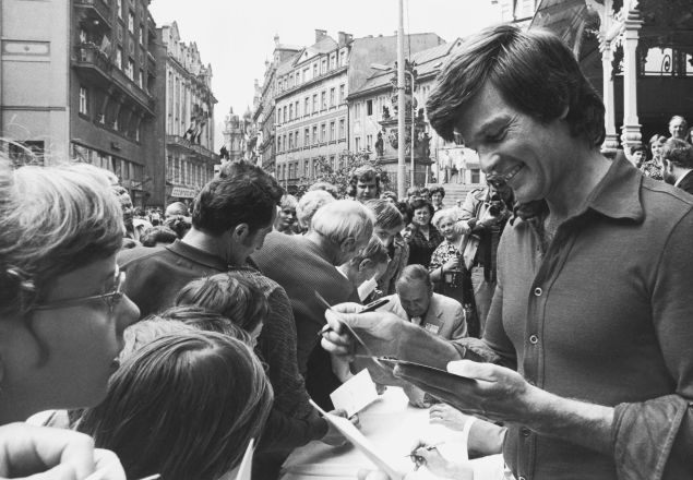 American film actor Dean Reed (1938 - 1986) signs autographs for fans in Czechoslovakia, circa 1976. Reed's left-wing political views led to settle in East Germany in 1973 and he became a major star throughout eastern Europe.