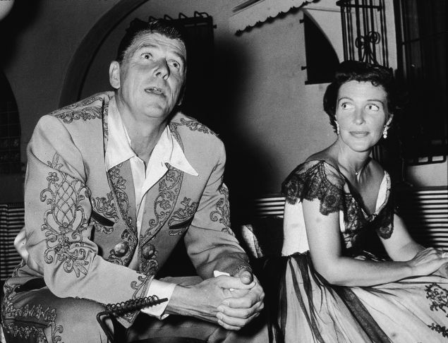 Future American president Ronald Reagan (1911 - 2004) and his wife Nancy Reagan at a costume party given by Rory Calhoun, 1950s.