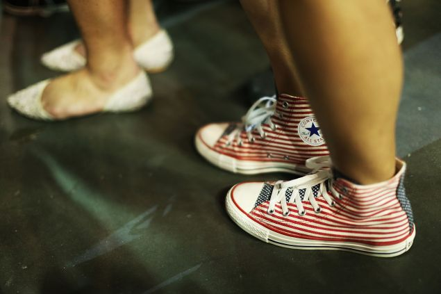 ORLANDO, FL - MARCH 05: A woman wears a pair of American flag colored sneakers as she waits for the arrival of Republican presidential candidate Donald Trump to speak at the CFE Arena during a campaign stop on the campus of the University of Central Florida on March 5, 2016 in Orlando, Florida. Primary voters head to the polls on March 15th in Florida.
