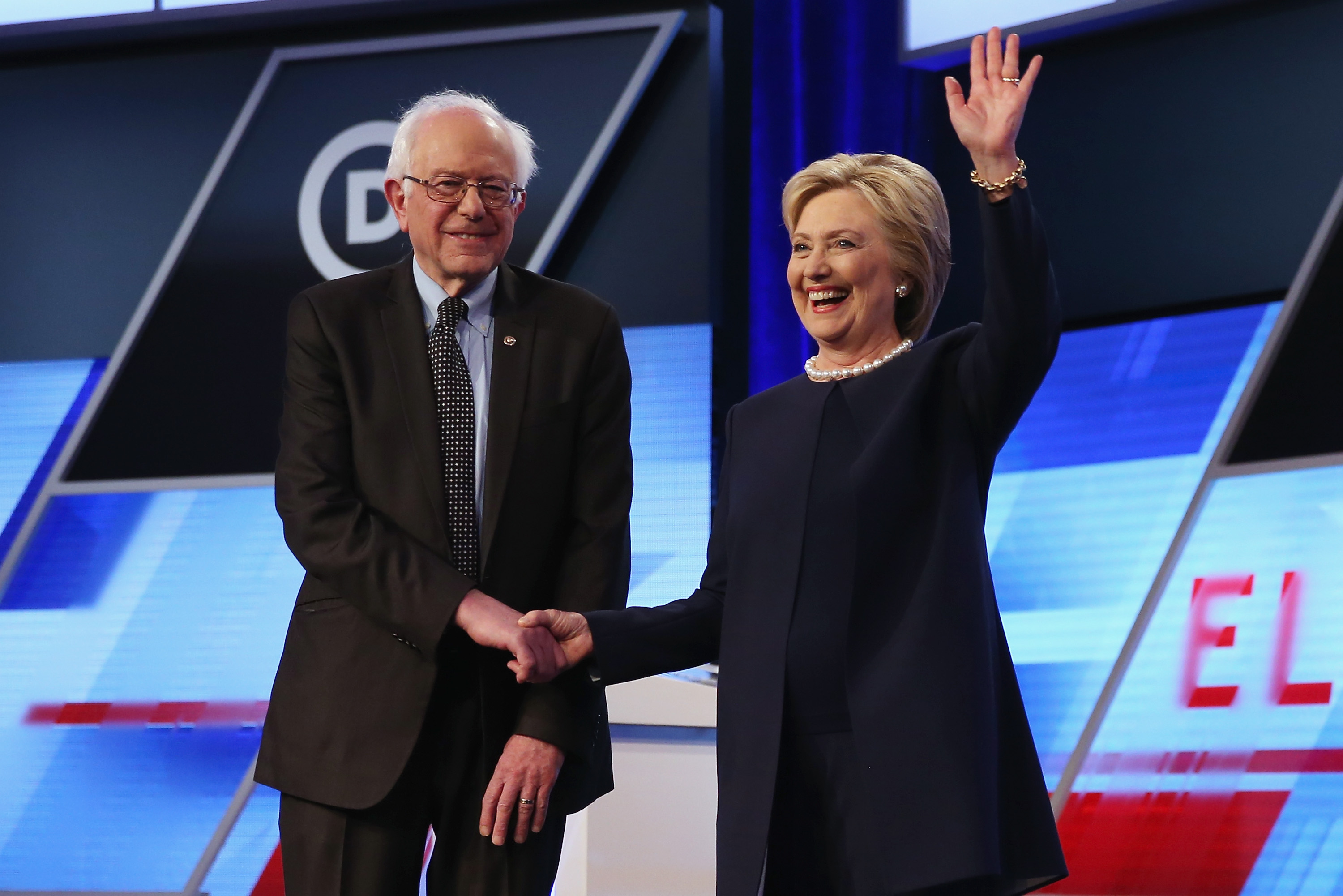 Democratic presidential candidates Senator Bernie Sanders (D-VT) and Democratic presidential candidate Hillary Clinton shake hands at a debate in March.