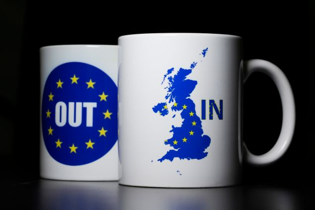 LONDON, UNITED KINGDOM - MARCH 17: In this photo illustration, the words 'IN' and 'OUT' are depicted on mugs on March 17, 2016 in London, United Kingdom. The United Kingdom will hold a referendum on June 23, 2016 to decide whether or not to remain a member of the European Union (EU), an economic and political partnership involving 28 European countries which allows members to trade together in a single market and free movement across its borders for citizens.