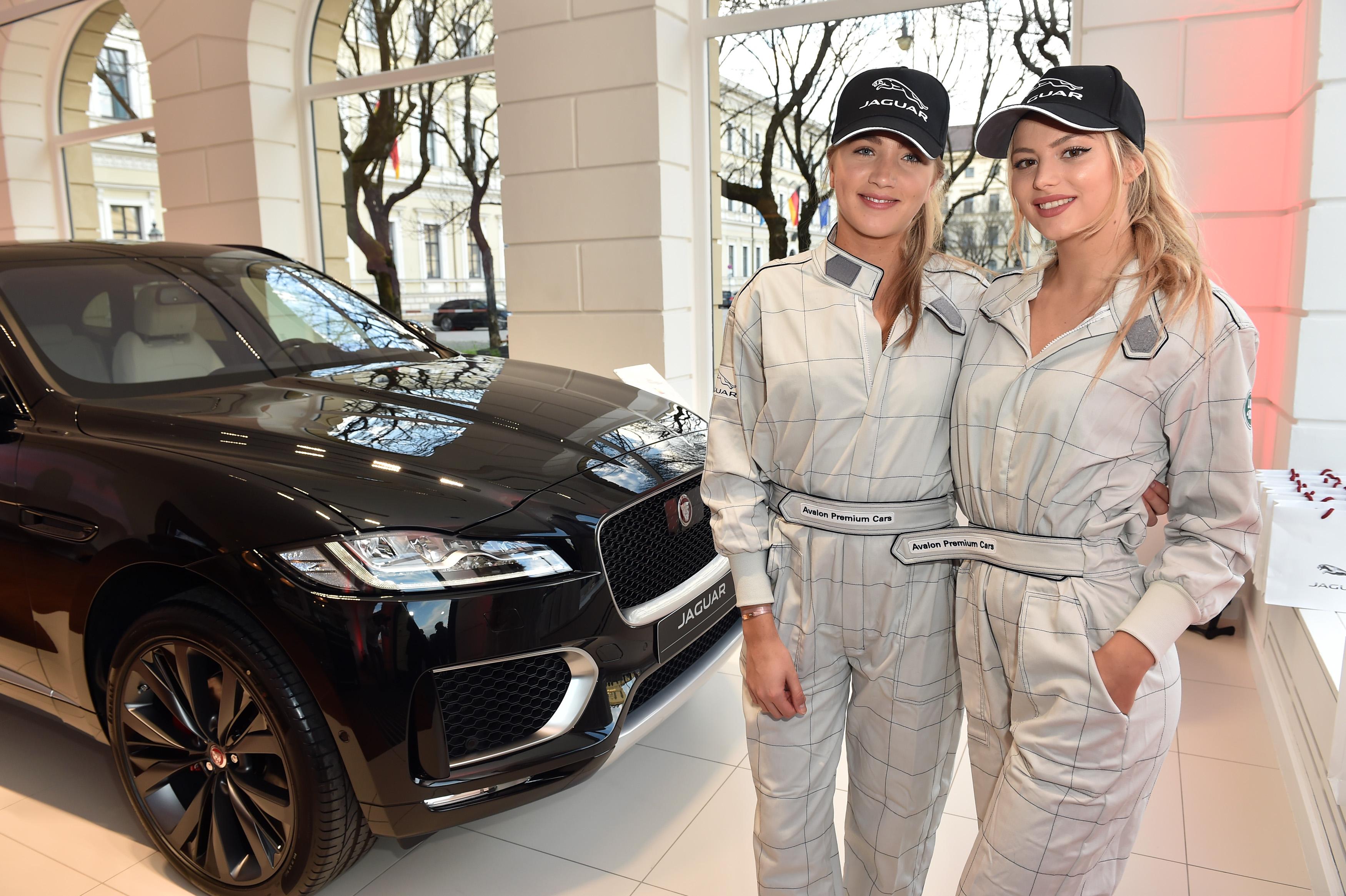 Models Teresa and Vivienne pose during the Jaguar presentation of the new Jaguar F-Pace at Jaguar & Landrover- Markenboutique Odeonsplatz on April 15, 2016 in Munich, Germany.