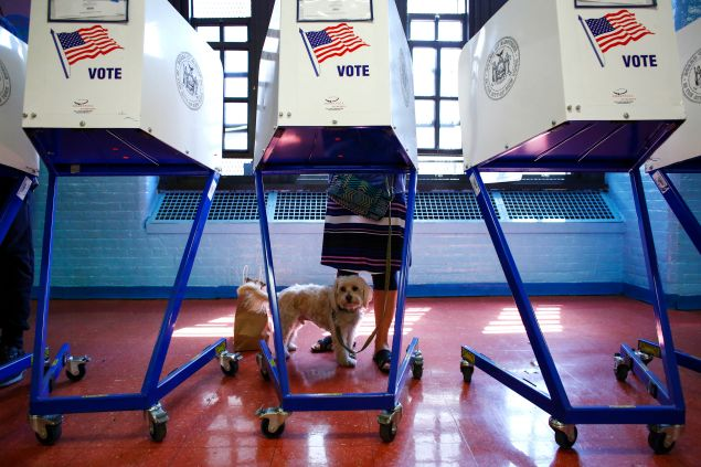 A woman casts vote at a polling station in Brooklyn, New York during the New York presidential primary April 19, 2016.