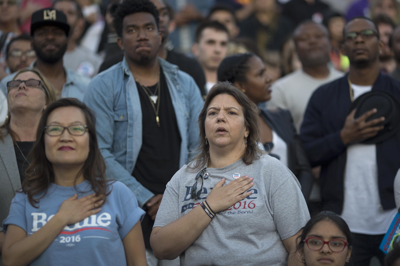 Voters recite the Pledge of Allegiance