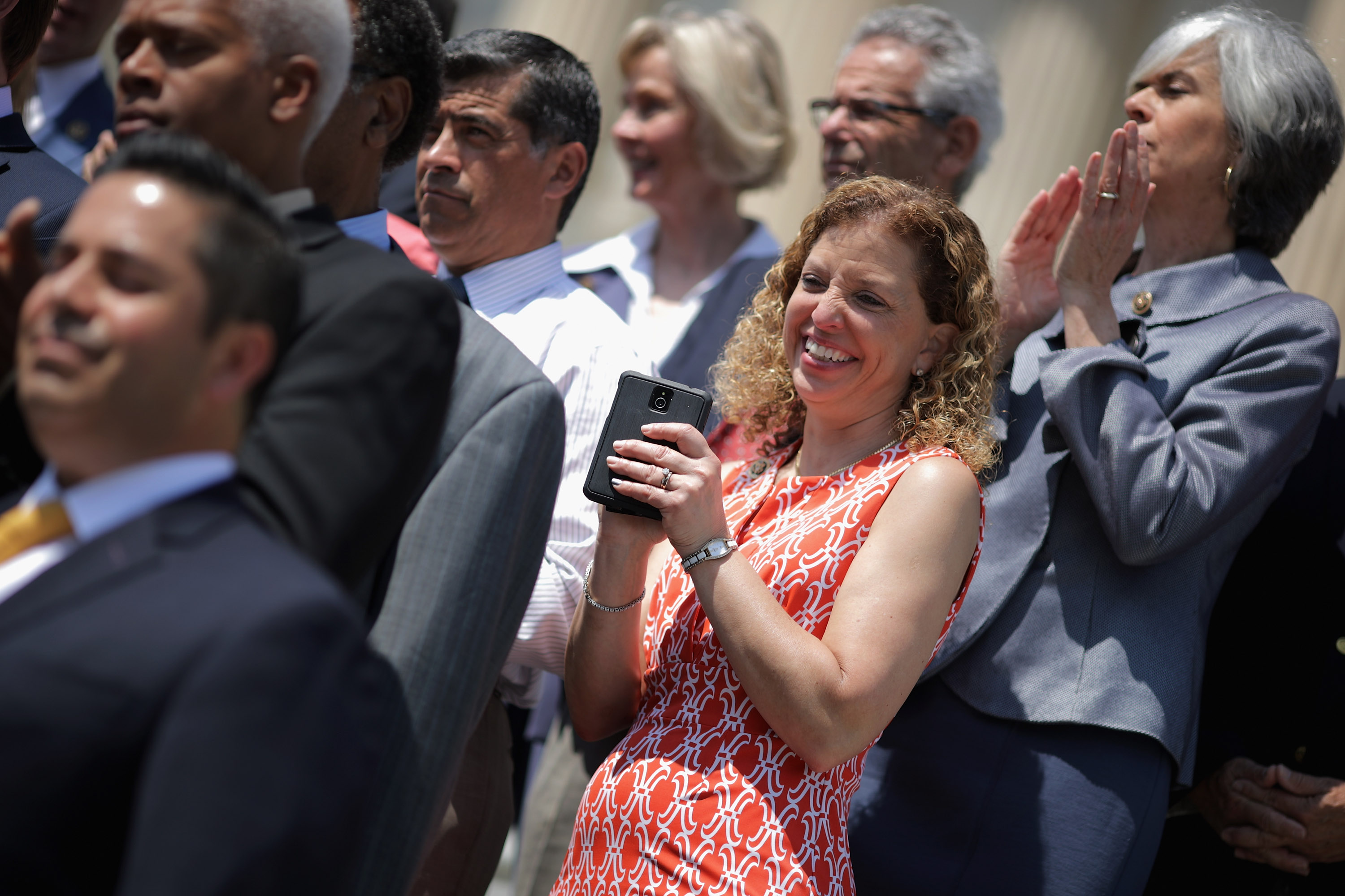 Democratic National Committee Chair Rep. Debbie Wasserman Shultz (D-FL) (C) joins fellow congressional Democrats to call on Republicans to postpone the Memorial Day holiday recess on the steps of the House of Representatives at the U.S. Capitol May 26, 2016 in Washington, DC. Democratic presidential candidate Sen. Bernie Sanders' (D-VT) campaign manager said, 'I think someone else could play a more positive role' as chair of the DNC than Wasserman Schultz, sparking rumors of her being forced from the position.