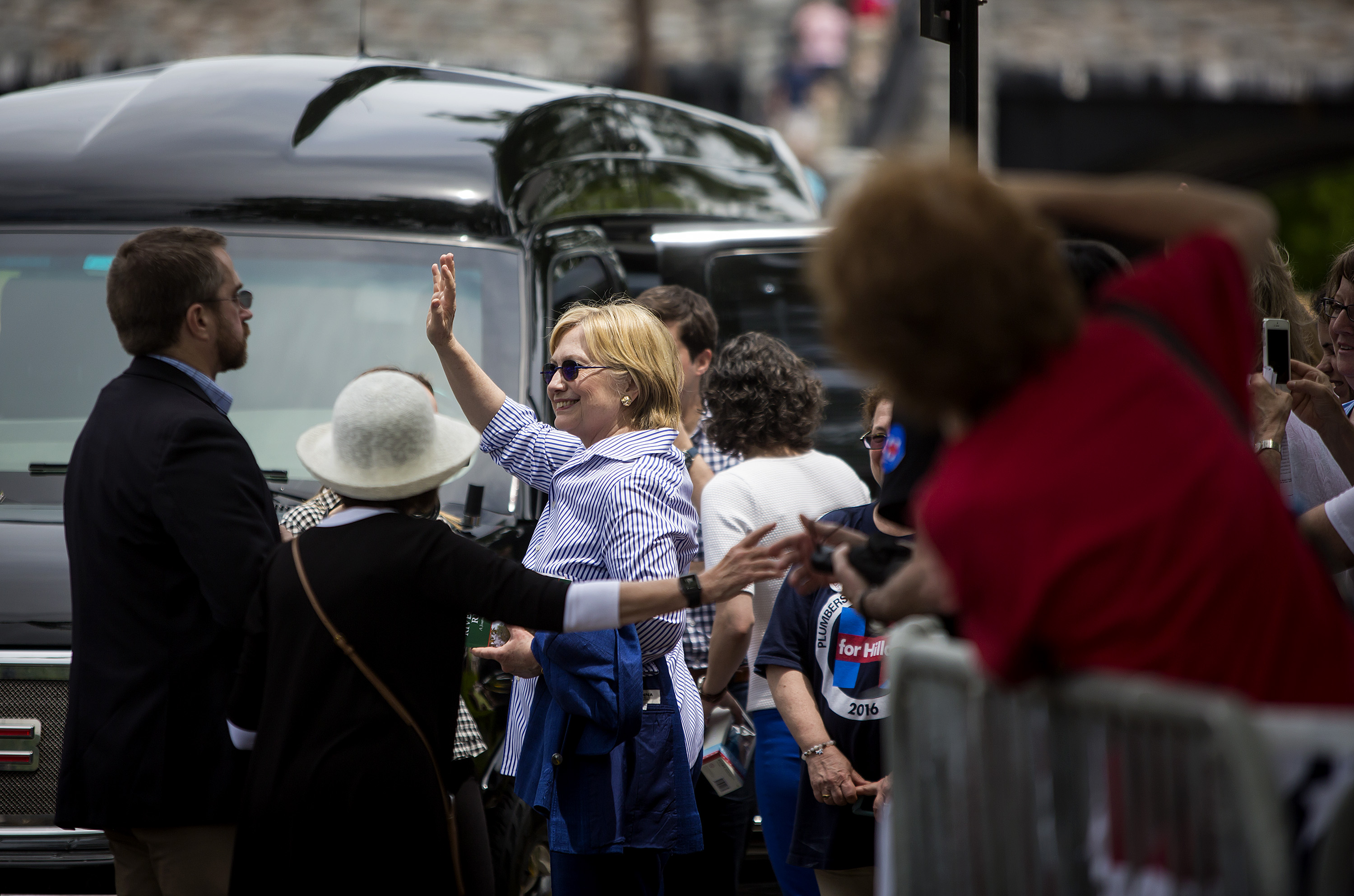 Democratic presidential candidate former Secretary of State Hillary Clinton departs after walking in the Memorial Day parade May 30, 2016 in Chappaqua, New York.
