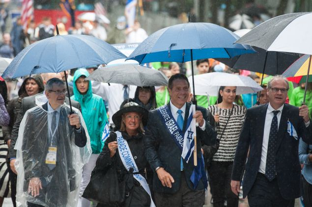 New York Gov. Andrew Cuomo marches in the Celebrate Israel Parade in the rain on June 5, 2016 in New York City.