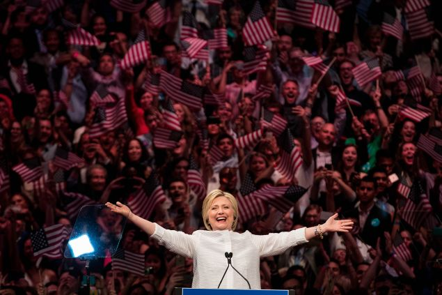 Hillary Clinton arrives onstage during a primary night rally at the Duggal Greenhouse in the Brooklyn Navy Yard, June 7, 2016 in the Brooklyn borough of New York City.