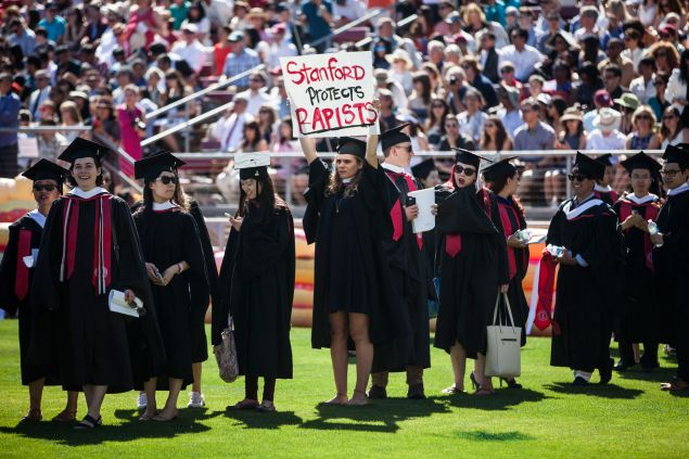 STANFORD, CA - JUNE 12: Graduating student, Andrea Lorei, who help organize campus demonstrations holds a sign in protest during the 'Wacky Walk' before the 125th Stanford University commencement ceremony on June 12, 2016 in Stanford, California. The university holds its commencement ceremony amid an on-campus rape case and its controversial sentencing.