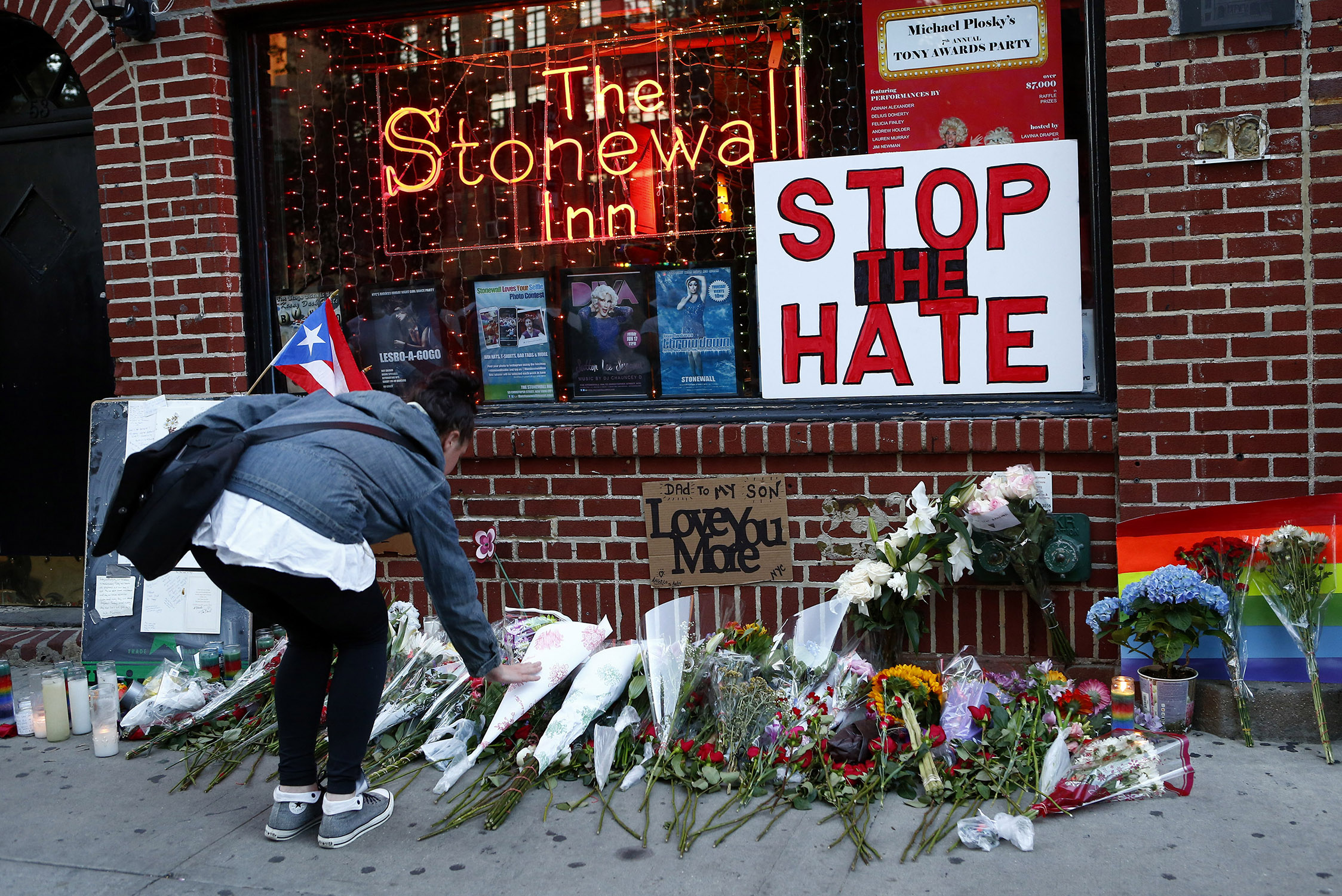 Flowers are placed at a make-shift memorial in front of the Stonewall Inn.