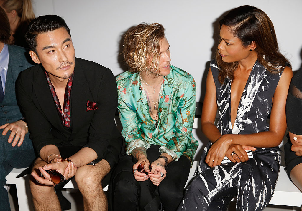 Hun Bing, Dougie Poynter and Naomie Harris attend the Songzio show during The London Collections Men SS17 at BFC Show Space on June 13, 2016 in London, England.