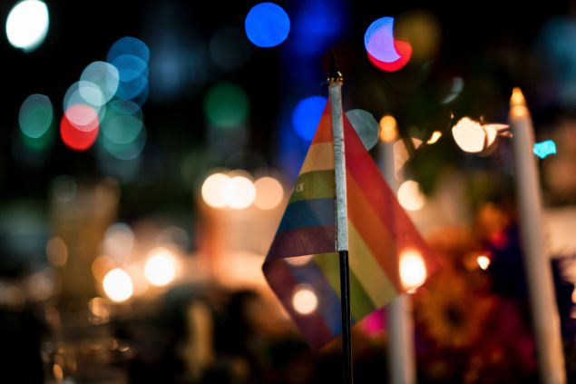A gay pride flag is seen at a memorial after a vigil outside the Dr. Phillips Center for the Performing Arts for the mass shooting victims at the Pulse nightclub June 13, 2016 in Orlando, Florida.