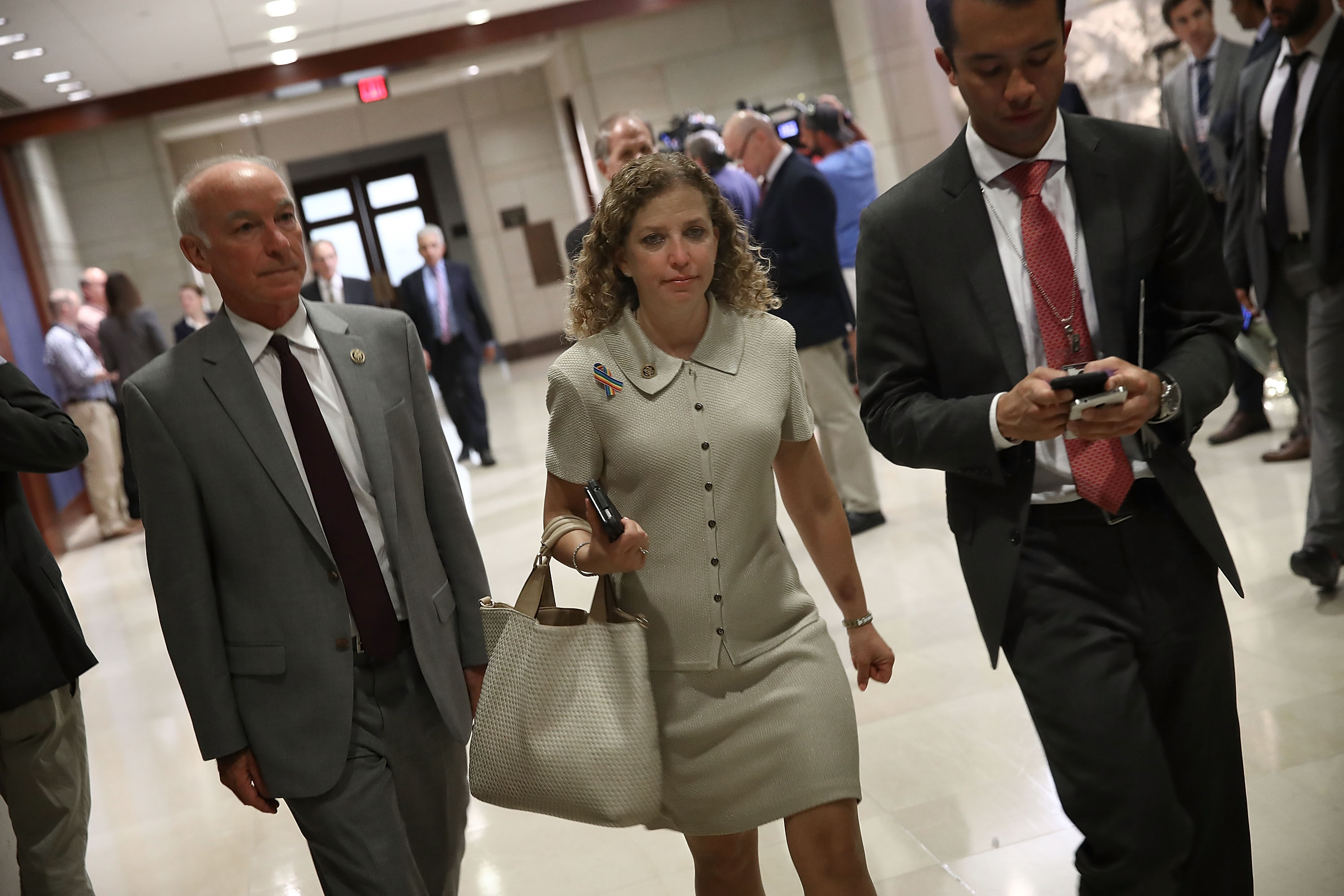 Democratic National Committee Chairwoman Rep. Debbie Wasserman Schultz (C) (D-FL) arrives for a closed briefing for members of the House of Representatives at the U.S. Capitol June 14, 2016 in Washington, DC. Members of the House received a briefing on the latest information surrounding the recent attack in Orlando, Florida.