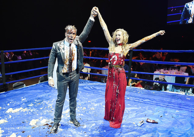 The comedian and the model in the ring, post-cake.