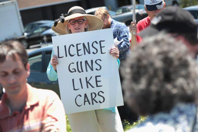 Anti-gun demonstrators protest outside DSA Inc. on June 17, 2016 in Lake Barrington, Illinois. DSA Inc. is a manufacturer of FAL, AR15 and RPD rifles.