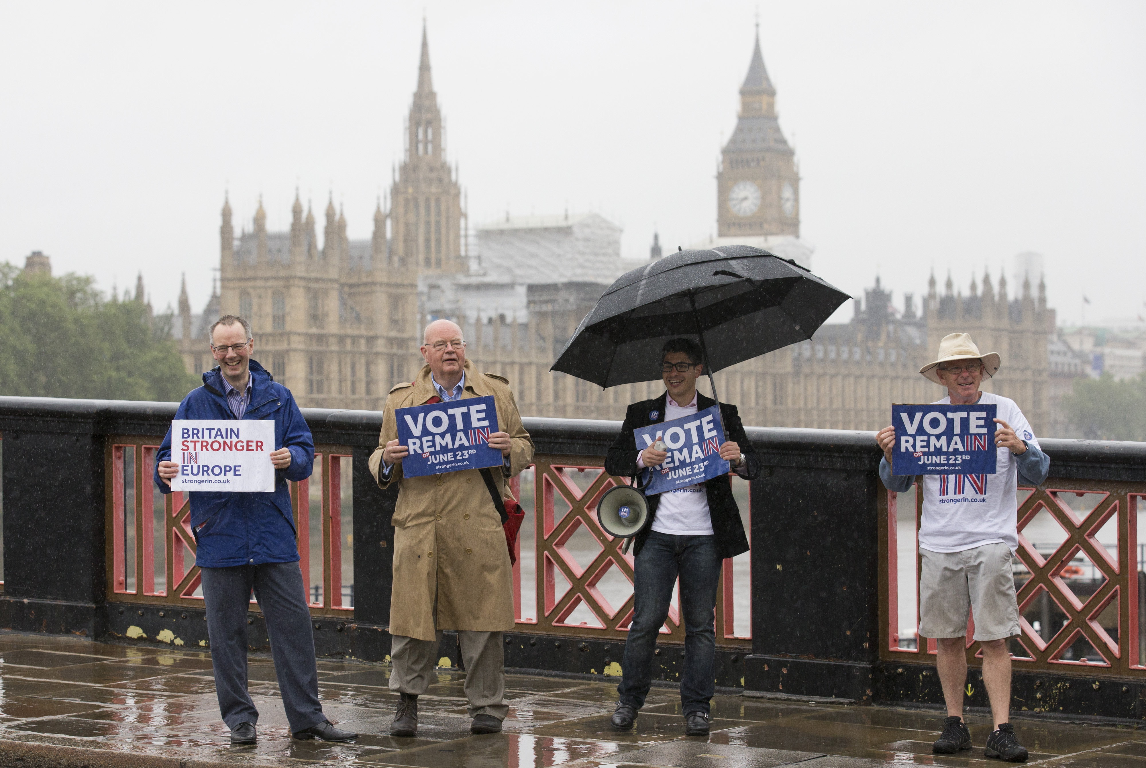 Campaigners hold placards for 'Britain Stronger in Europe', the official 'Remain' campaign group seeking to avoid a Brexit, ahead of the forthcoming EU referendum, in London on June 20, 2016.