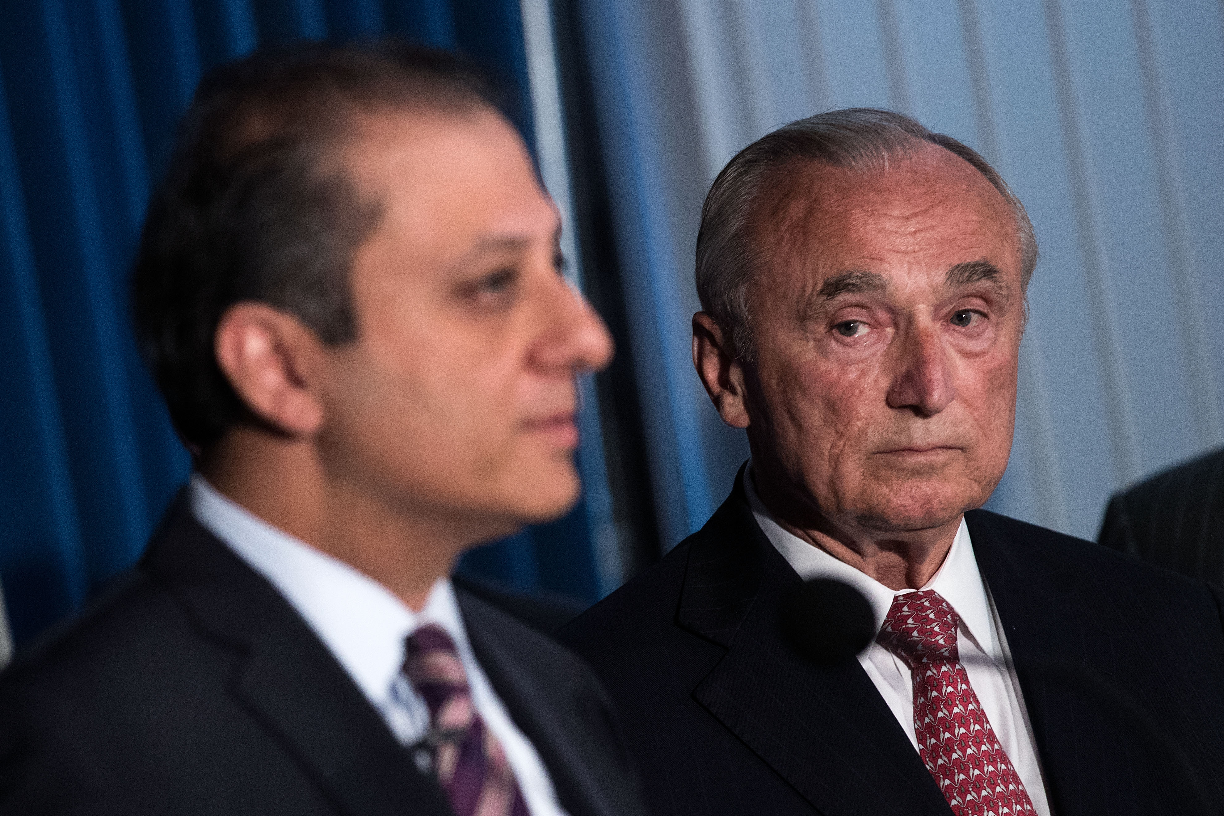 NYPD Commissioner Bill Bratton, right, looks on as U.S. Attorney Preet Bharara, outlines an NYPD corruption case.