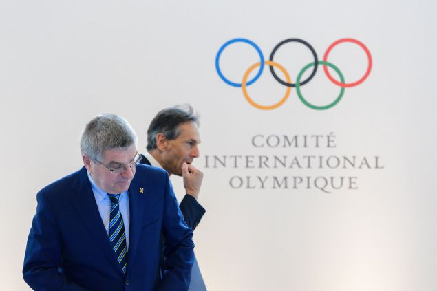 International Olympic Committee (IOC) president Thomas Bach (L) and IOC director general Christophe De Keeper arrive for the opening of an Olympic summit on June 21, 2016 in Lausanne. For Russia's track and field stars, the meeting of Olympic executives may offer the last chance to compete at the Games in Rio de Janeiro.