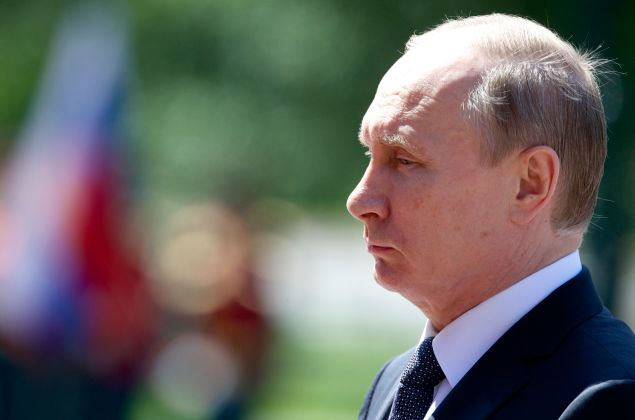 Russian President Vladimir Putin attends a wreath-laying ceremony marking the 75th anniversary of the Nazi German invasion, by the Kremlin walls in Moscow on June 22, 2016.