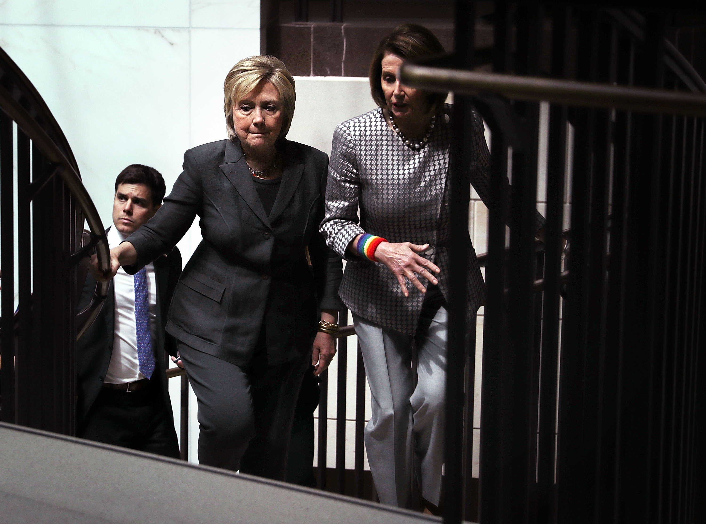Accompanied by House Minority Leader Rep. Nancy Pelosi (D-CA) (R), Democratic presidential candidate Hillary Clinton leaves after she met with House Democrats June 22, 2016 on Capitol Hill in Washington, DC. Clinton joined the House Democratic Caucus meeting as she continued to campaign for the election.
