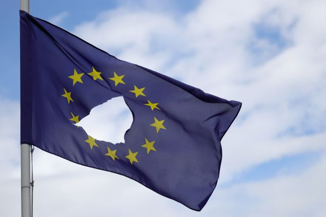 KNUTSFORD, UNITED KINGDOM - JUNE 24: A European Union flag, with a hole cut in the middle, flies at half-mast outside a home in Knutsford Cheshire after today's historic referendum on June 24, 2016 in Knutsford, United Kingdom. The results from the historic EU referendum has now been declared and the United Kingdom has voted to LEAVE the European Union.