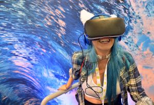 ANAHEIM, CA - JUNE 24: A VidCon attendee experiences Samsung Gear VR at The Samsung Experience at VidCon 2016 on June 23, 2016 in Los Angeles, California.