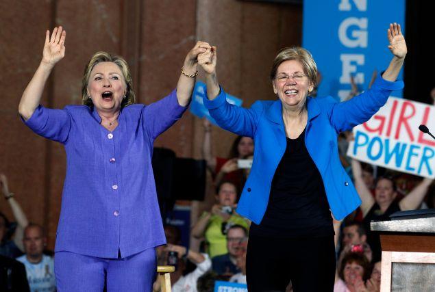 CINCINNATI, OH- JUNE 27:  Democratic Presidential candidate Hillary Clinton (L) and U.S. Sen Elizabeth Warren (D-MA) (R) wave to the crowd before a campaign rally at the Cincinnati Museum Center at Union Terminal June 27, 2016 in Cincinnati, Ohio. Warren is helping Clinton campaign in Ohio.