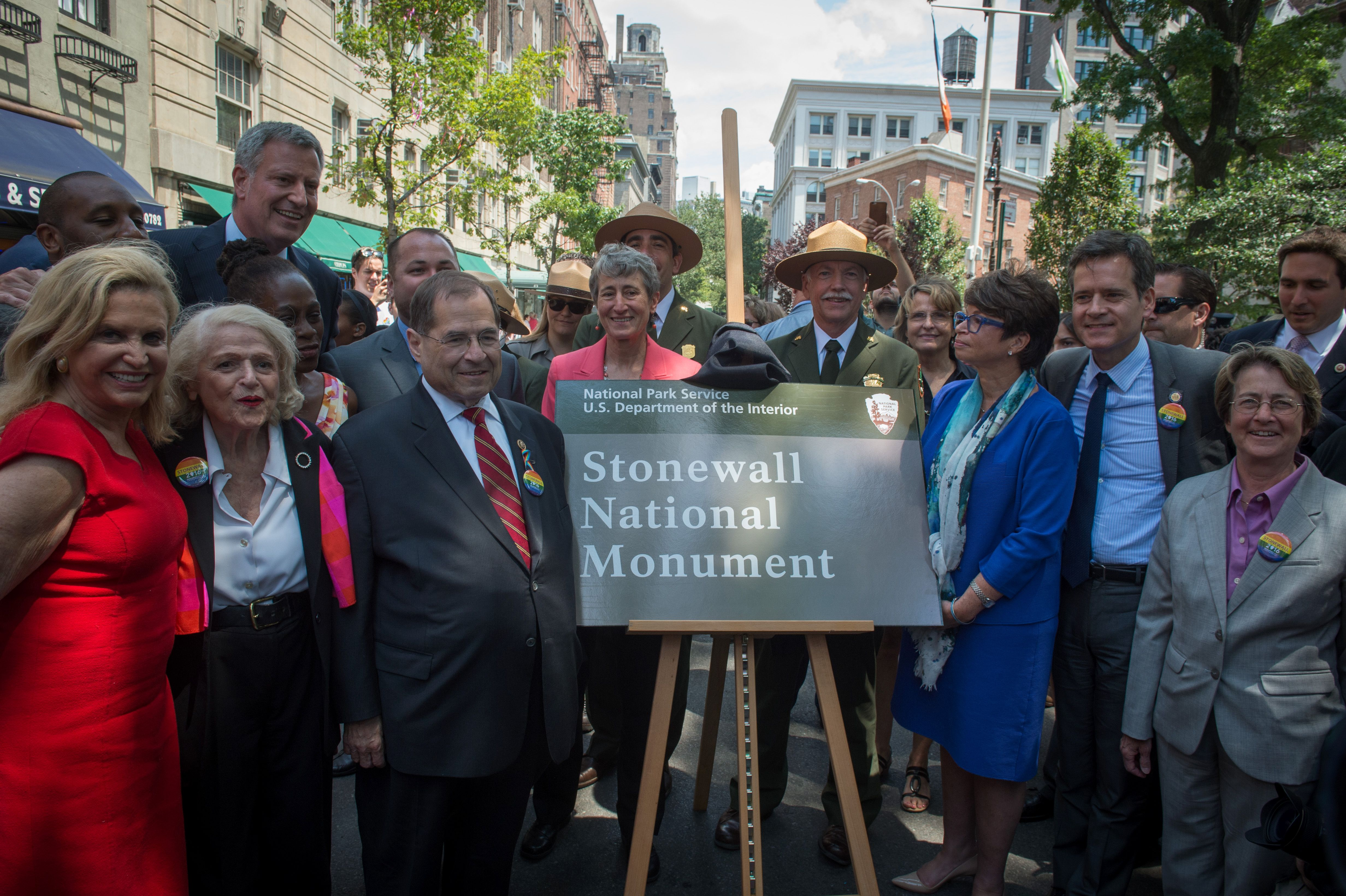 New York officials and activists unveil the sign designating Stonewall Inn a National Monument.