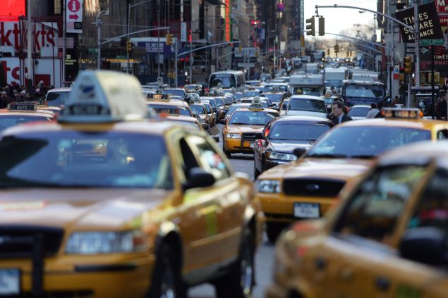 Traffic makes its way through Times Square on March 23, 2006 in New York City.
