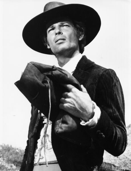 Actor and singer Dean Reed dressed as a cowboy in a scene from a film, circa 1975.