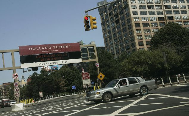 Police arrested three individuals carrying weapons outside the Holland Tunnel.