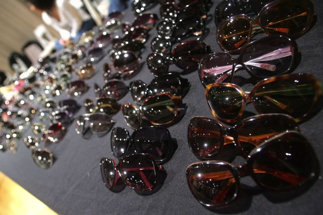 An array of sunglasses featured at a sample sale
